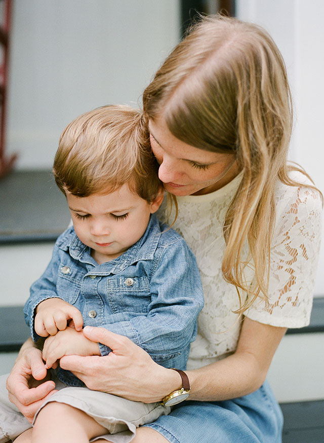 Mom and son snuggle and hold hands Sarah Der Photography