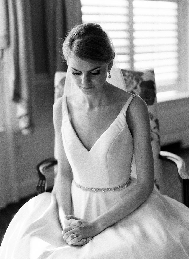 classic and elegant black and white photo of bride sitting in chair - Sarah Der Photography