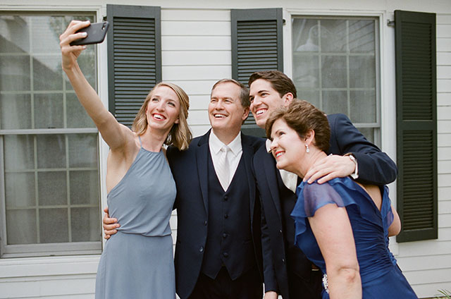 groom and family take selfie - Sarah Der Photography
