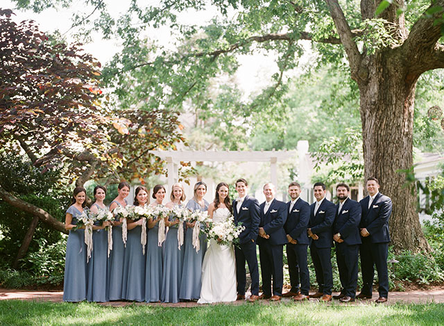 Bridal party lined up outside the fearrington inn - Sarah Der Photography
