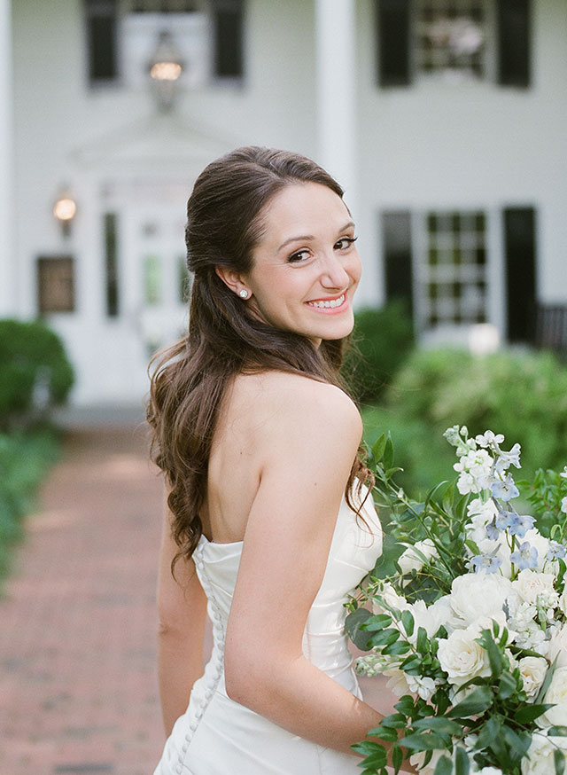 Film bridal portrait at Fearrington of bride smiling and looking back  - Sarah Der Photography