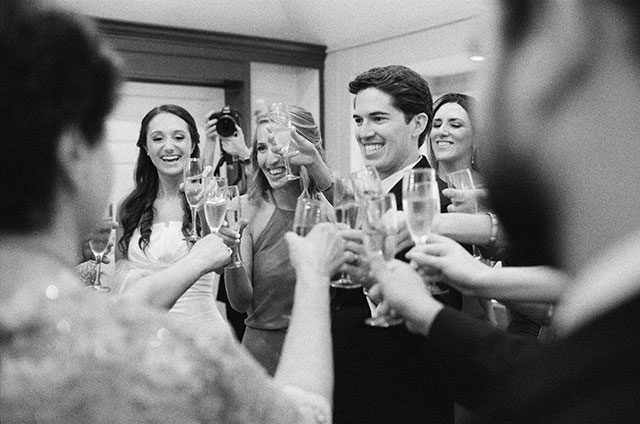 celebrating with champagne - Sarah Der Photography