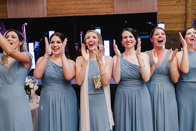 bridal party claps and cheers and bride and groom enter reception - Sarah Der Photography