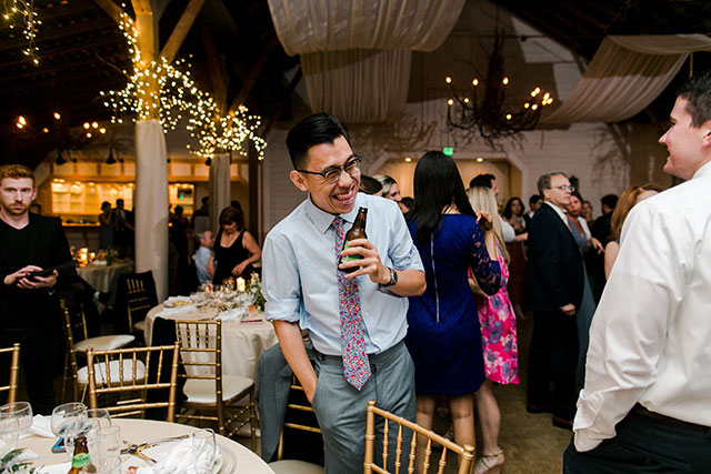 guest laughing at reception - Sarah Der Photography