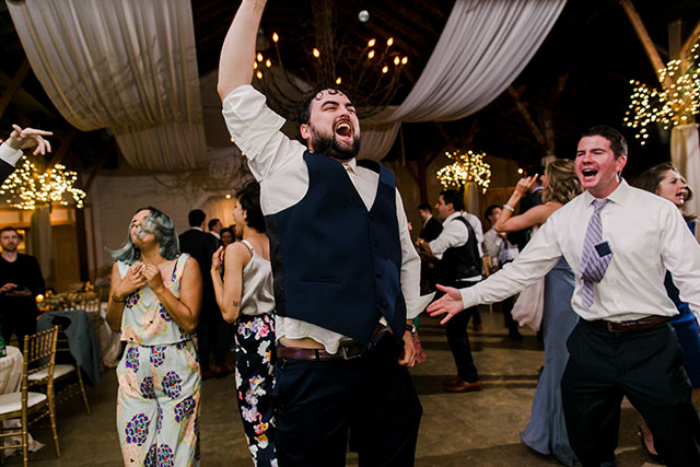 guest dancing like crazy at reception - Sarah Der Photography