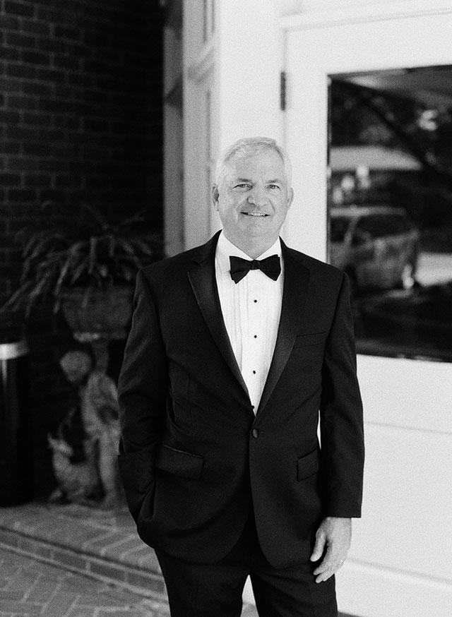 portrait of bride's father shot on ilford 3200 black and white film