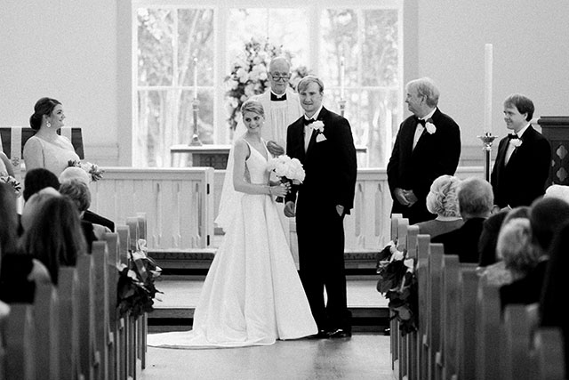 bride and groom look at guests