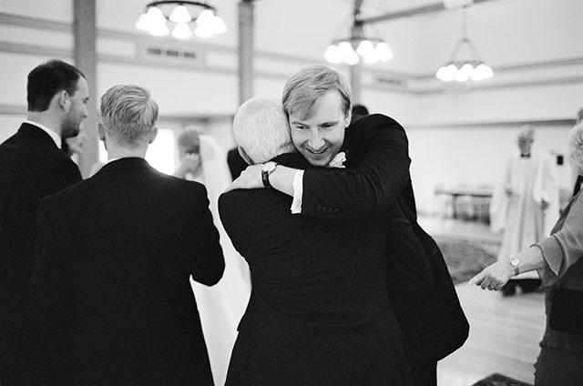groom hugs dad after ceremony