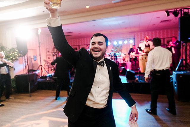 groomsman dancing at reception