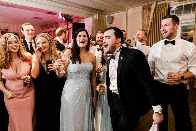 bridesmaid singing at reception