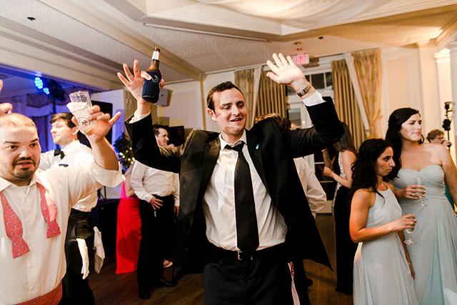 dancing and singing at CCV wedding reception
