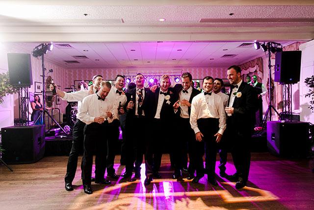 groom serenades bride on wedding day