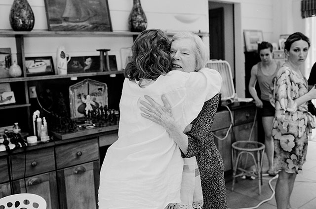 meaningful photo of grandma and bride hugging - Sarah Der Photography