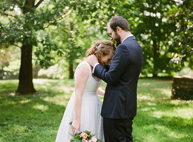 sincere reaction of first look, groom hugs bride - Sarah Der Photography