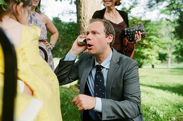 dad talks on shoe phone  - Sarah Der Photography
