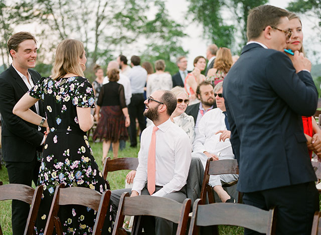 Candid photo of guests before the ceremony begins