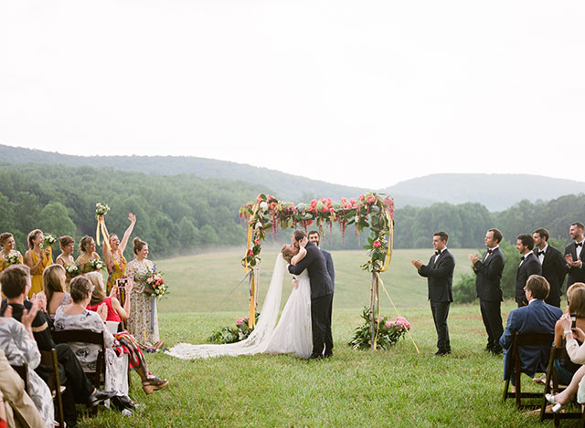 first kiss at outdoor ceremony in virginia