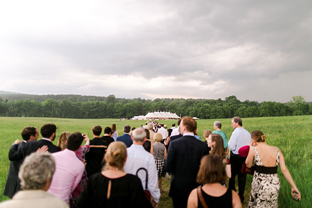 guests walk in a line down to the reception site