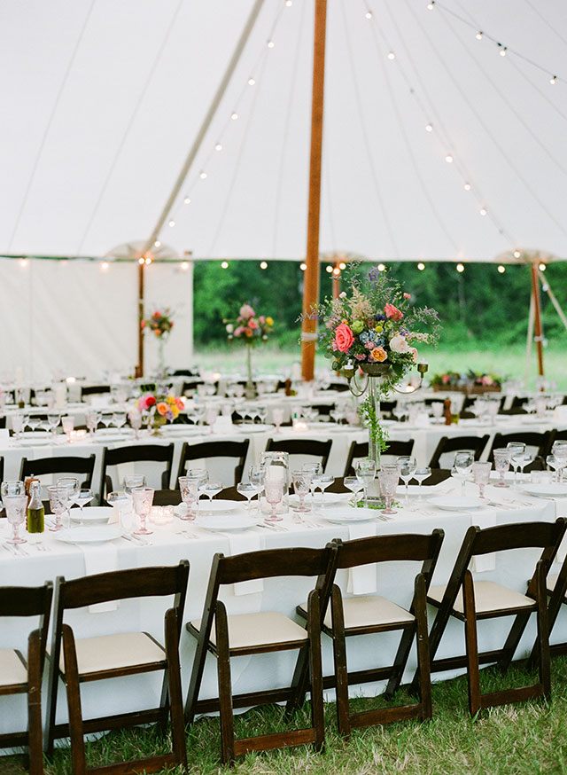 outdoor tent reception with city celebrations