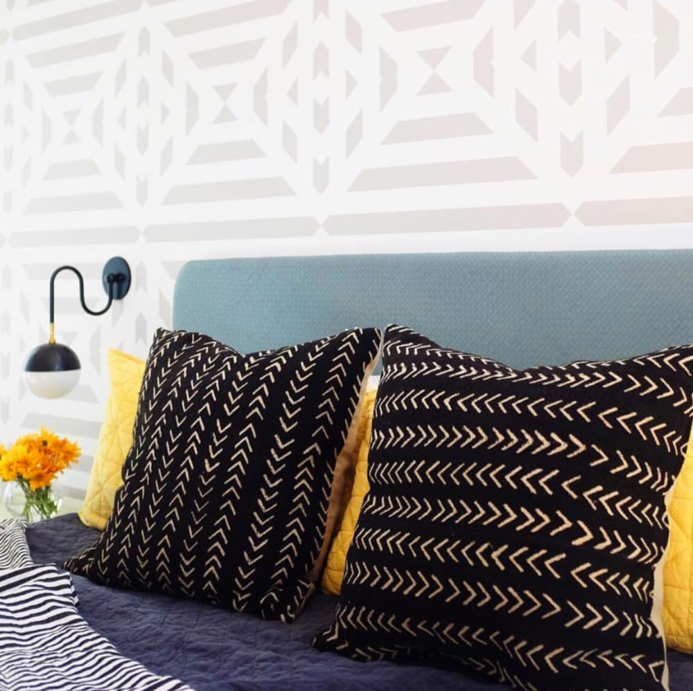 Geometric patterns mix so well. - Interior design by Consort Design