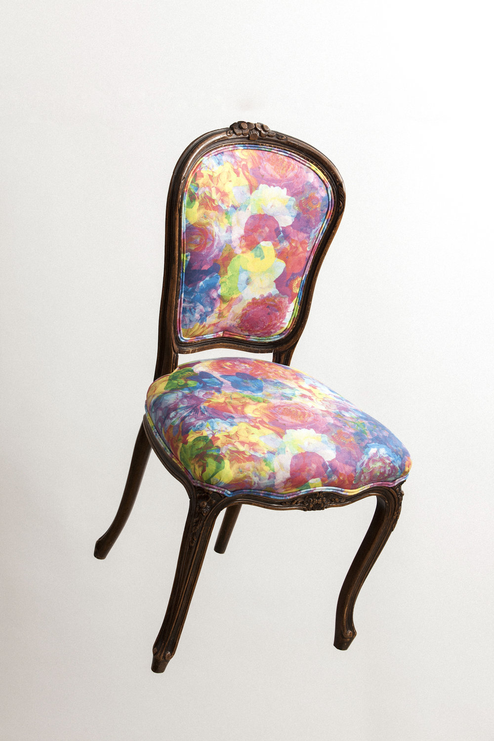 Chairloom refinished and recovered these beautiful antique dining chairs for us using our candy colored  Wildflowers fabric .