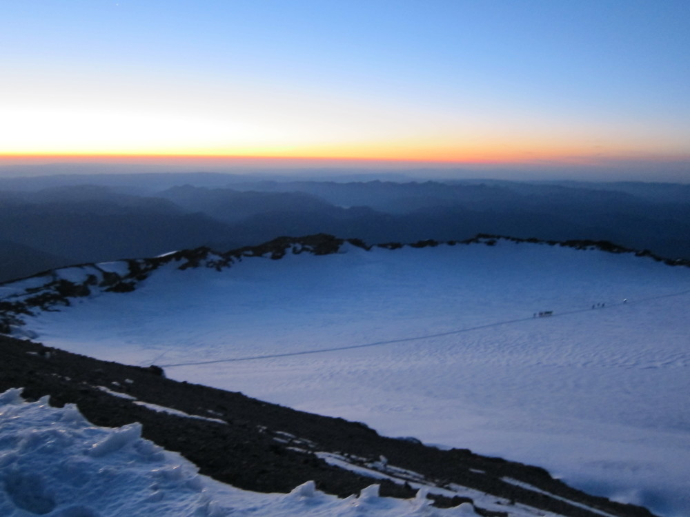 Looking across the crater of Mt. Rainier just before sunrise.