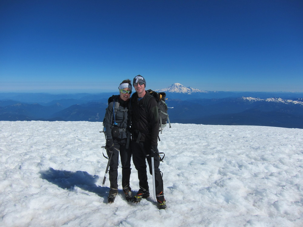 Summit of Mt. Adams with Mt. Rainier in the background.