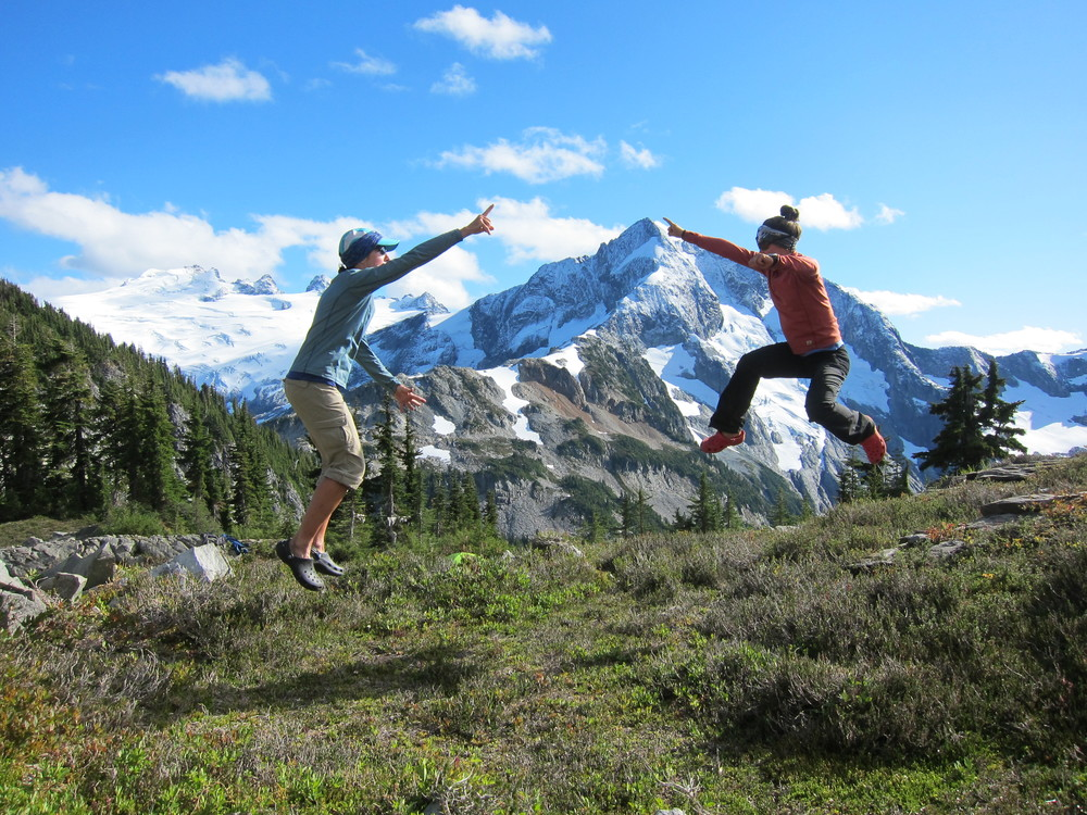 "The infamous ""pointing leap"" in front of Challenger and Whatcom Peaks, North Cascades."