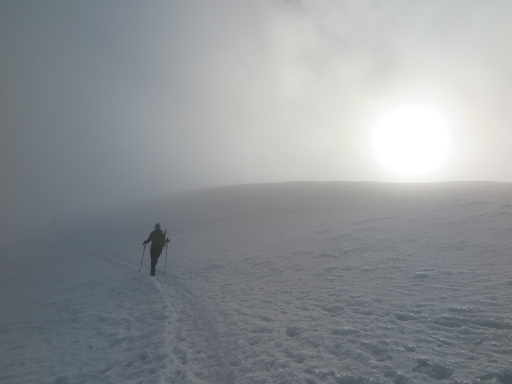 Traversing from Piker's Peak to the final summit push in a cloud - with the sun just barely breaking through.