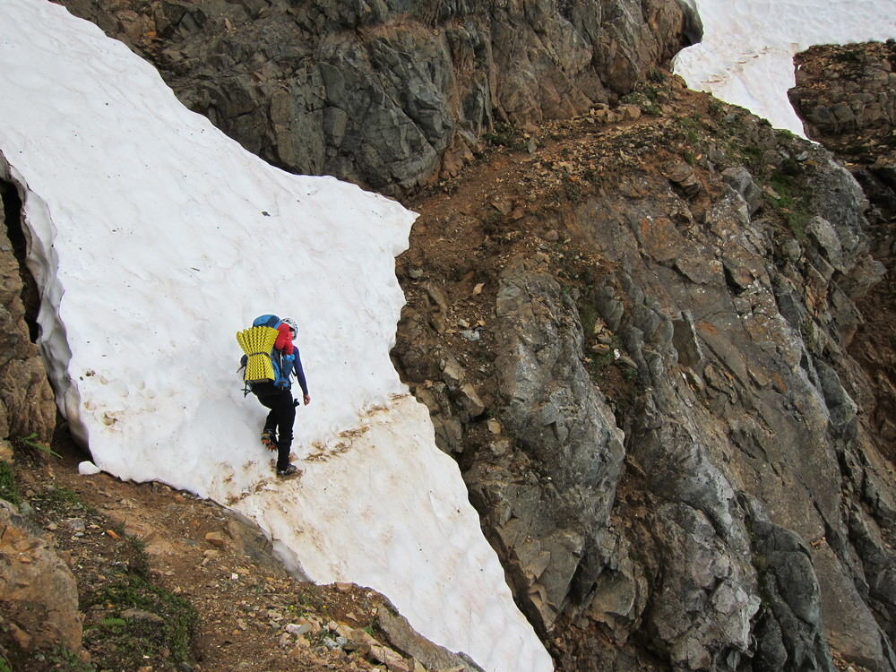 Perfect example of a spot where an ice axe wouldbe an appropriate accessory. (Red Ledges, Ptarmigan Traverse, North Cascades)