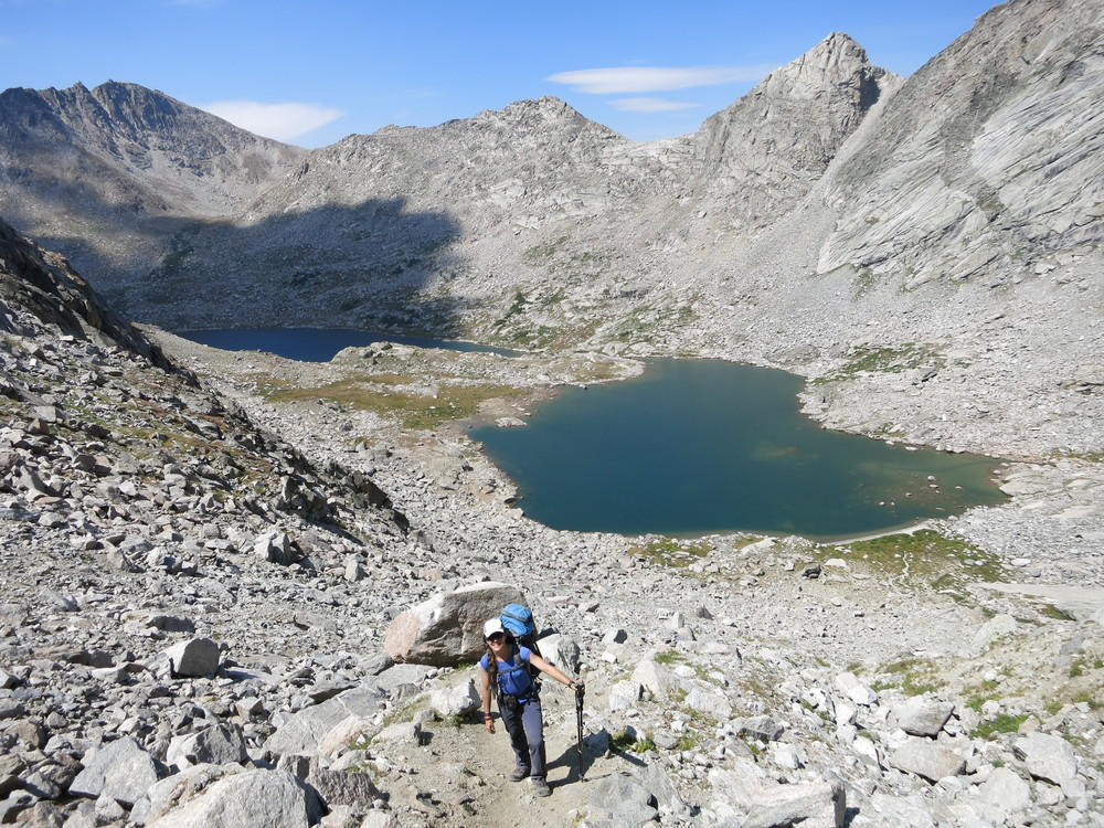 Ascending to Texas Pass amidst granite and alpine lakes.