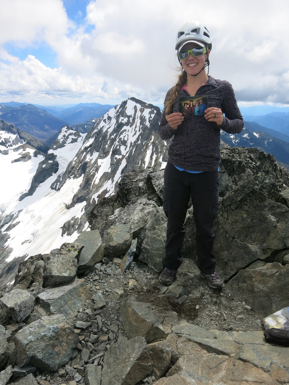 Holding a photo with my grandfather on the summit of 7FJ. Mt. Maude in the background.