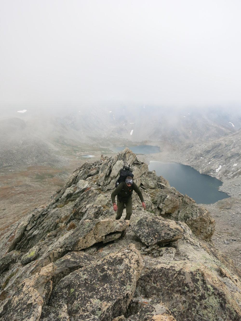 Aaron, scrambling up the knife's edge ridge on Europe Peak.