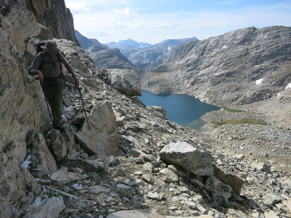 Hugging the wall towards Douglas Peak Pass. Lake 10787 in the background.