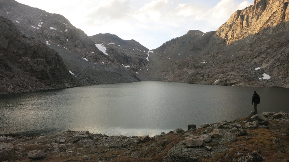 Near our Campsite at Alpine Lakes Basin. Alpine Lakes Pass is the low point in the middle of the photo.