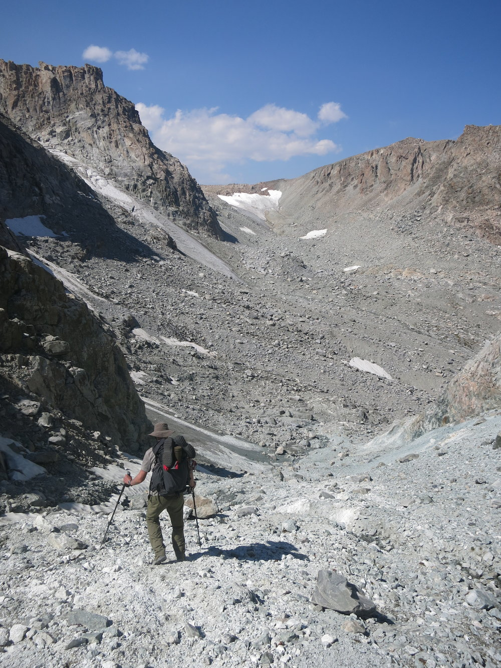 Beginning the steep descent from the gully. Our next objective is that ice patch in the distance below the horizon.
