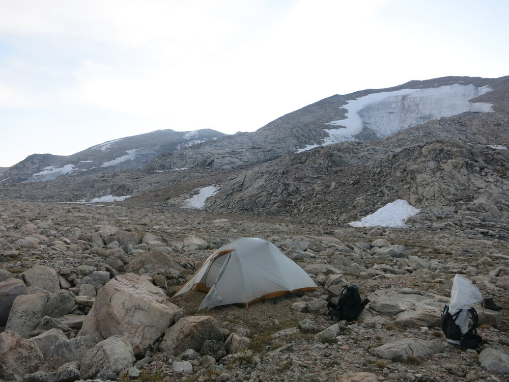 Our final campsite of the route.  The snow slope we descended earlier in the day is seen behind us.