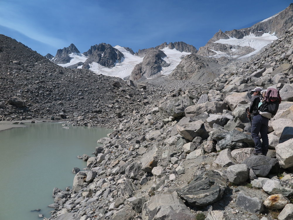 Earlier in the trip, hiking through glacial moraines after West Sentinel Pass.