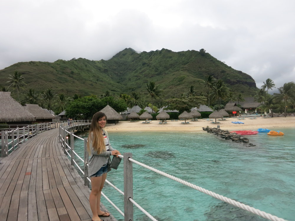 On the overwater bungalow deck with the resort and Mt. Rotui in the background.