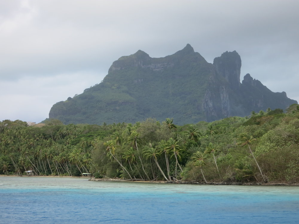 Arriving in Bora Bora with the first few glimpses of Otemanu. Surprisingly, Otemanu has never been climbed - the rock is extremely poor quality (crumbly) and will not hold any climbing protection.