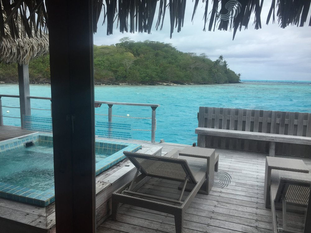 Private deck with a hot tub.  The ladder leads down to a dock where you can jump into the water for snorkeling.