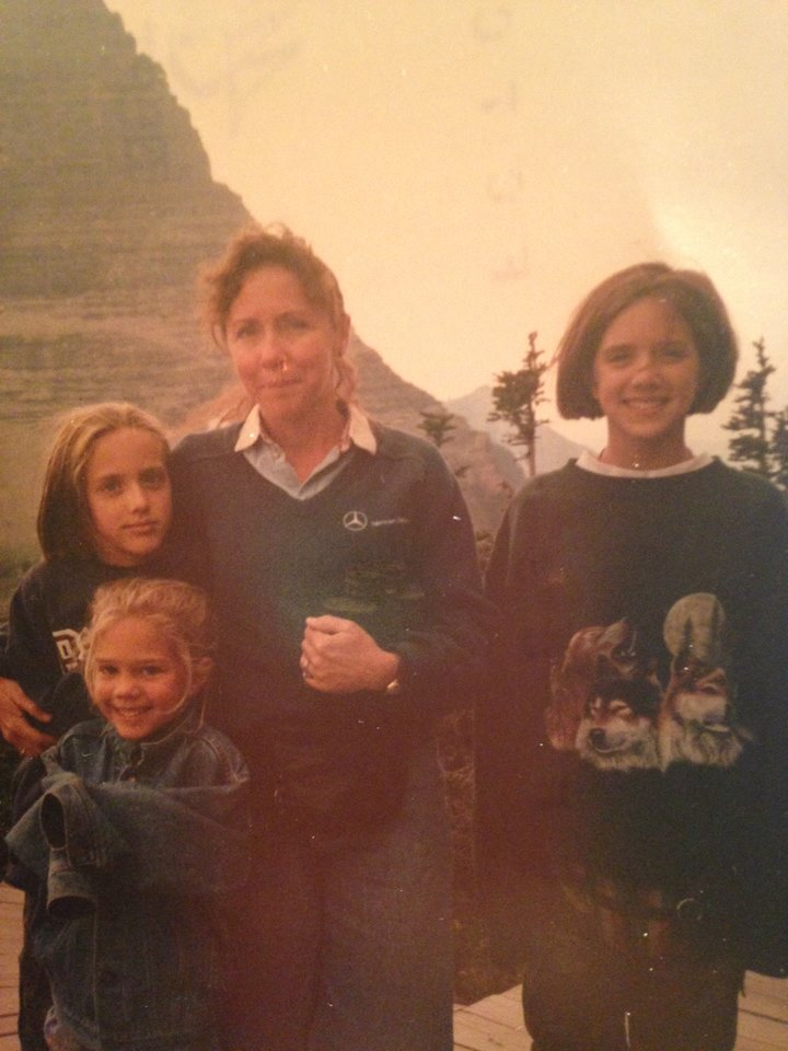 Me (on the right), howling wolf sweat shirt and fanny pack. At Glacier National Park.