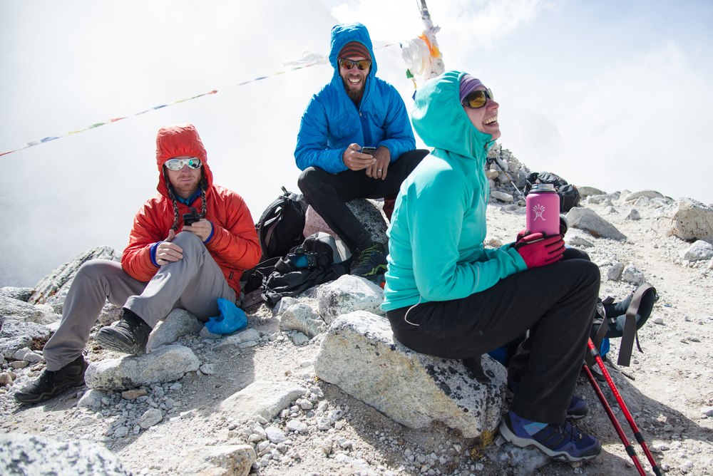 Scott Rogers, Cody Tuttle, and Cherise Tuttle make it to the summit of Larke Pass, 5,200 Meters. Keeping the world up to speed on their adventures via inReach global texting. photo: brian mosbaugh