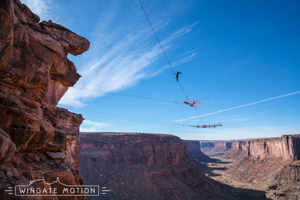 Andy Lewis preparing to walk a highline strung between 2 space nets with nothing but a BASE parachute for protection. Photo: Cody Tuttle