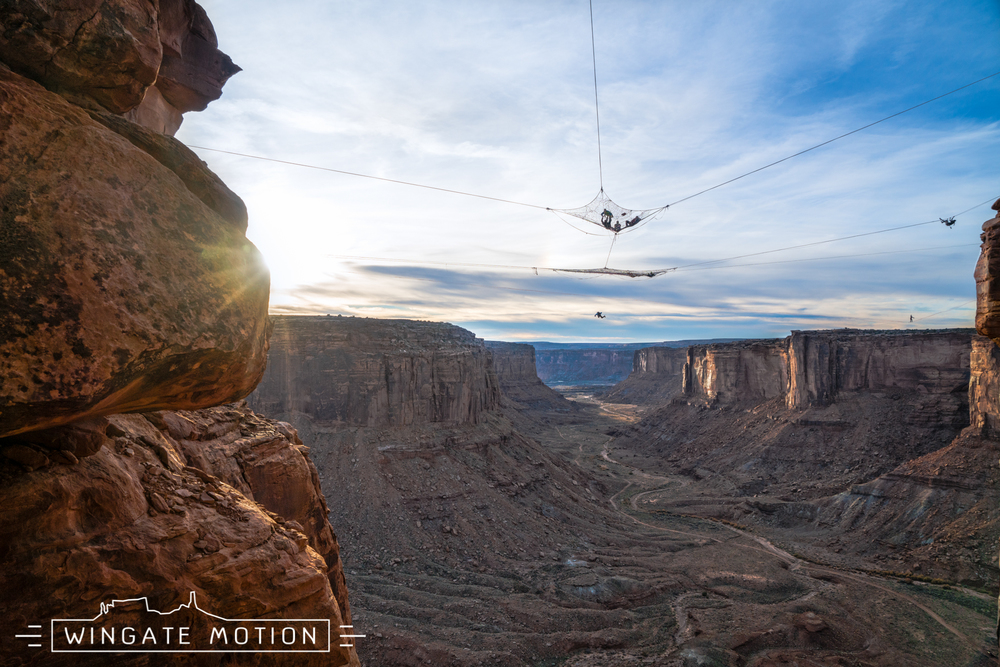 Words cannot describe this expression of art, better known as the Space Net. In one photo many different mediums are being practiced: BASE jumping out of the space net's portal, yoga performed in the net, and fighting the 700+ ft mental demon of a highline in the background. Come as you are and experience the family. Photo: Cody Tuttle