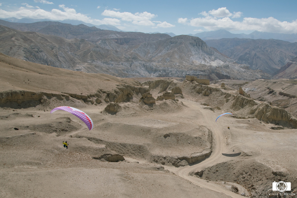 Jamie Messenger and Cody Tuttle take their first flights in the Mustang outside the walled city of Lo Manthang. Photo: Nick Greece