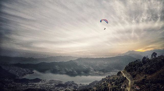 Sailing into the heavens.  Photo: @codytutts  #gopro #paragliding #skyhigh