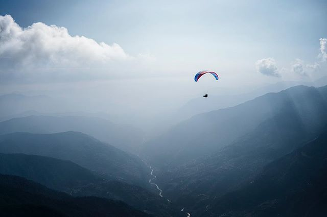 These moments are what keeps us searching.  Photo @codytutts #paragliding #himalaya #nepal