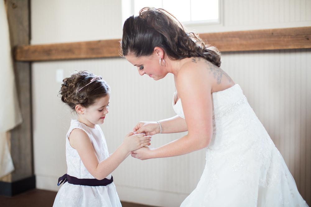 bride giving flower girl a gift