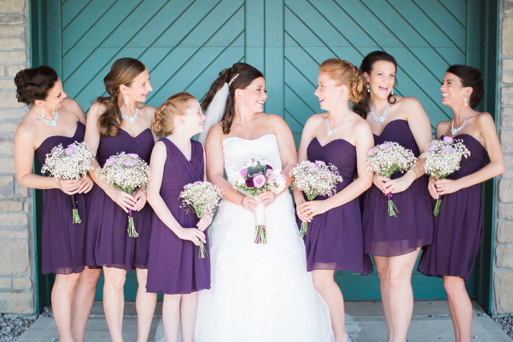 bride and her bridesmaids at muhlhauser barn